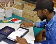 Phumani Archival Mill product developer and papermaker Sipho Mabaso fits the handmade archival packaging he crafted for an artist's limited edition sketchbook range. Photo: Supplied