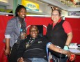 Umhlobo Wenene FM's breakfast show DJ, Putco Mafani (centre), gives blood during the South African National Blood Service drive at Pier 14 last week. Keeping an eye on the patient are the radio station's portfolio sales manager Phelisa Silekwa (left) and SANBS registered nurse Patricia Gallant (right). Photo: Supplied
