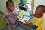 South African children reading at a donated library.