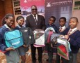 Executive mayor Zanoxolo Wayile with children from Malabar Primary School, who were assisted by the Education Task Team.