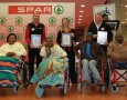 One hundred Nelson Mandela Bay residents received brand-new wheelchairs as part of the SPAR Wheelchair Wednesday campaign. Pictured here at Wednesday's handover ceremony are (from left) SPAR's Anton Gerber, Wendy Westraadt and Abri Swart with four of the happy beneficiaries. Photo: Full Stop Communications